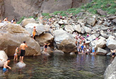 crowd of people near or in a river