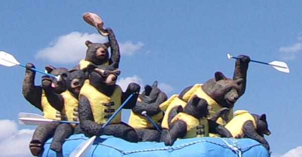 sculpture of bears enjoying rafting