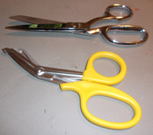 two pairs of scissors, one with pointed ends and one with blunt ends