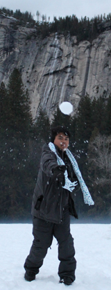 man throwing a snowball with the snowball in mid-air