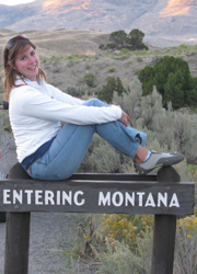 Alanna on Montana sign photo by Mark Nevill 250 pixels: girl sits on sign that says entering montana