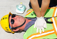 CPR compressions photo by Joyce Kuo: gloved hands in place to do CPR compressions, photo by Joyce Kuo