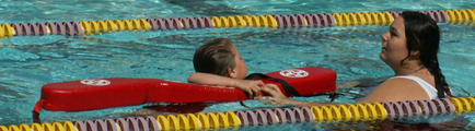 Crystalandswimmer2007tri120 pixels: girl clings to rescue tube lifeguard just gave her