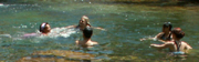 Denie swims across the swimming hole: