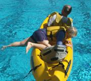 Georgine climbing into kayak: