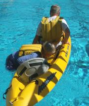 Georgine starting to climb into kayak: