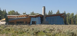 Grand Teton visitor center at Moose nps photo: sagebrush in foreground, building with two story windows
