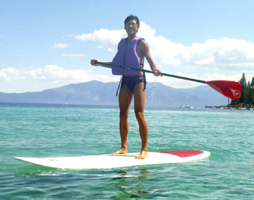 Howard Mok stand up paddle board unknown photographer: smiling man on a stand up paddleboard on Lake Tahoe
