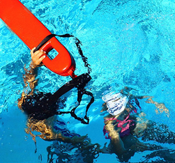 Joyce Kuo photo swim class lifeguard assist 234 pixels: rescue tube as surface and two people underwater