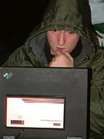 Michael & computer at campfire by Colin Underwood: