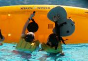 Mimi and Karen right the kayak: