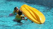 Mimi and Karen start to flip kayak: