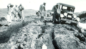 NPS 1920s car on deeply rutted road: 1920s car stuck in mud on deeply rutted road