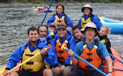 OutdoorClubgroupphoto2011raft 150 pixels: white water rafters, some with their paddles