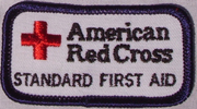 Red Cross standard first aid patch: a patch that says Red Cross Standard First Aid