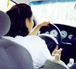 Renae at wheel on road trip by Wendy Sato: