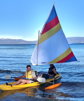 Chris Throm and Jennifer Chiou sailing photo by Alpana Shekar: guy and gal in an ocean kayak with sail kit