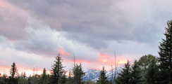 Schwabacher landing sunset 2010 120 pixels photo by Alan Ahlstrand: mostly clouds, some mountains and trees
