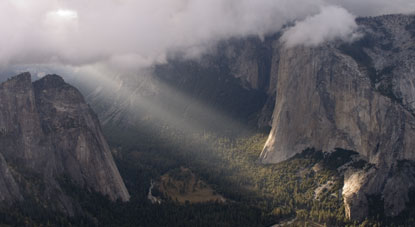 NPS photoTaft Point view of sun streaming thru clouds to El Capitan: