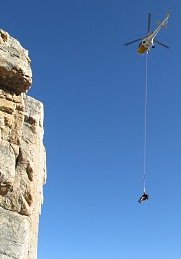 Teewinot rescue NPS photo: rescuer and rescued victim hang below a helicopter