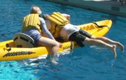 William climbing into kayak: