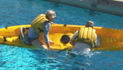 William starting to climb into kayak: