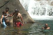 a helping hand getting across slippery rocks: