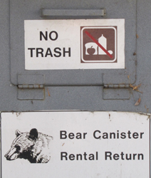 bear canister rental return: a sign that says bear canister rental return