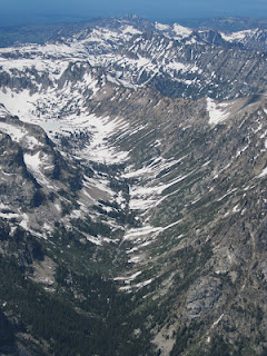 NPS photo cascade canyon from summit of grand teton june 28 2012: a canyon as seen from above with patchy snow