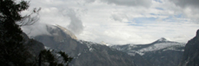 clouds moving in across Half Dome:
