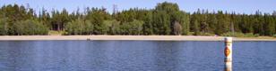 colter bay swim beach: a long beach as seen from the lake