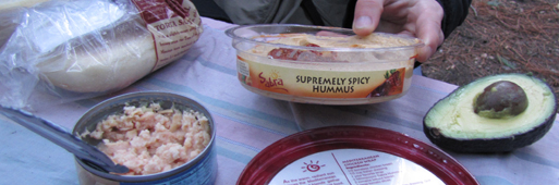 extremely spicy hummus: breakfast items including a can of tuna, an avacado and a package of extremely spicy hummus