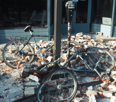 fallen unreinforced brick facade vs bicycles Loma Priena quake USGS photo: