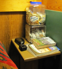 large mouse proof snack containers: large plastic mouse proof snack containers on a bedside table
