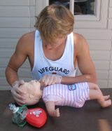 lifeguard Ethan Wilkie checks for object 187 pixels: lifeguard Ethan Wilkie checks for object in manikin mouth