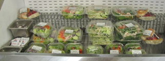 lodge food court salad selections: salads in plastic take-out containers