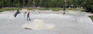 main bay Jackson Hole skate park: two skaters in skate park
