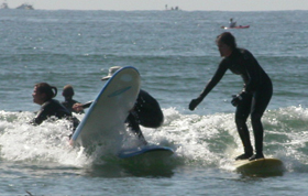 may 05 surf wipeout instructor and standing: