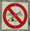 no diving warning symbol in pool tiles: