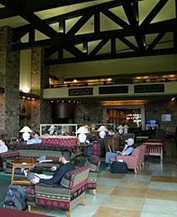 nps photo Jackson lake lodge upper lobby: people sitting on couches in room with two story high ceiling