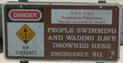 ocean beach warning sign people have drowned here: