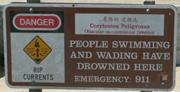 ocean beach warning sign people have drowned here:
