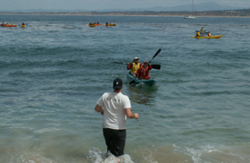 one kayak at a time comes in to shore 2006: