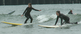 one standing one getting up 2006 April surf: