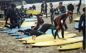 surfing practice: We practice standing up on boards on the beach before we go out.