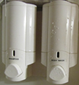shampoo and soap dispensers: shampoo and soap dispensers mounted on a shower wall