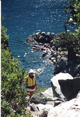 Fannette I: hiker on trial to the top of Fannette Island looking down towards cove with kayaks below