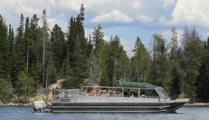 shuttle boat on Jenny lake: shuttle boat underway on Jenny lake