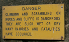 sign danger climbing on rocks: