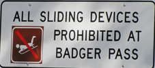 sign sliding devices prohibited: a sign that says all sliding devices prohibited at Badger Pass